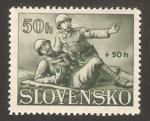 Stamps Slovakia -  socorriendo herido de guerra