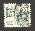 Stamps : Asia : India :  844 - vivienda, espiga y tractor