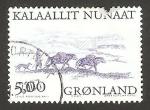 Stamps Europe - Greenland -  hombre con su perro y dos caballos con carga