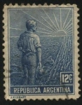 Stamps of the world : Argentina :  Labrador surcando la tierra con arado de mano. Sol naciente.