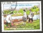 Stamps : Asia : Laos :  883 - plan quinquenal, ayuda médica