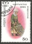 Stamps Kyrgyzstan -  40 - mujer con un tapiz