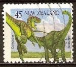 Sellos de Oceania - Nueva Zelanda -  Animales prehistóricos. Carnosaur y el saurópodo.