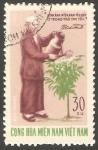 Stamps : Asia : Vietnam :  Regando un árbol