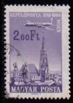 Sellos de Europa - Hungría -  Avión sobevolando ciudades