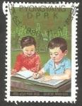 Sellos del Mundo : Asia : Corea_del_norte :  1844 - 40 anivº de la UNESCO, niños coreanos aprendiendo a escribir
