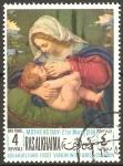 Stamps United Arab Emirates -  VIRGEN  AMAMANTANDO  EL  NIÑO  SOBRE  UN  COJÌN  VERDE.  SOLARIO.