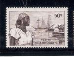 Sellos de America - Guadeloupe -  Mujer  y barco de vela