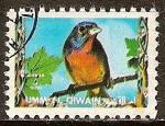 Sellos del Mundo : Asia : Emiratos_Árabes_Unidos : El azulillo pintado o colorín sietecolores (Passerina ciris).