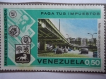 Stamps of the world : Venezuela :  Paga tus Impuestos -Más Vias de Comunicaciones-  Ministerio de Hacienda