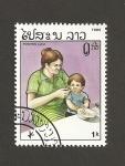 Sellos de Asia - Laos -  Madre cuidando niño