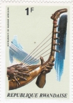 Stamps Rwanda -  instrumento musical africano
