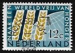 Sellos de Europa - Holanda -  Tres espigas de maiz delante del globo