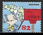 Sellos de Asia - Japón -  Charlie Brown with stream of letters