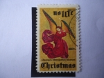 Stamps of the world : United States :  Navidad 1974- Ángel-Altarpiece- Museo Metropolitano.