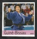 Stamps : Africa : Guinea_Bissau :  Olimpiadas de Atenas, Xian Dongmei, judo