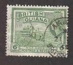Stamps : America : Guyana :  Cosechadora de arroz
