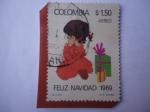 de America - Colombia -  Feliz Navidad 1968 -. Niña con Regalos de Navidad.