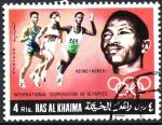 Stamps Asia - United Arab Emirates -  COOPERACIÓN  INTERNACIONAL  EN  LAS  OLIMPÍADAS.  KEINO  GANADOR  DE  CARRERA.