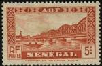 Sellos del Mundo : Africa : Senegal : Puente de Faidherbe sobre el rio Senegal, y nativos en canoa.