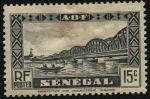 Sellos de Africa - Senegal -  Puente de Faidherbe sobre el rio Senegal, y nativos en canoa.