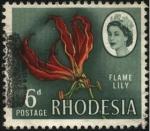 Sellos del Mundo : Africa : Zambia : Rhodesia. LILY FLAME. Planta Gloriosa de las tuberosas, herbáceas deciduas y perennes.
