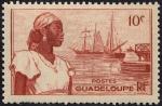 Sellos del Mundo : America : Guadeloupe : Mujer y barcos
